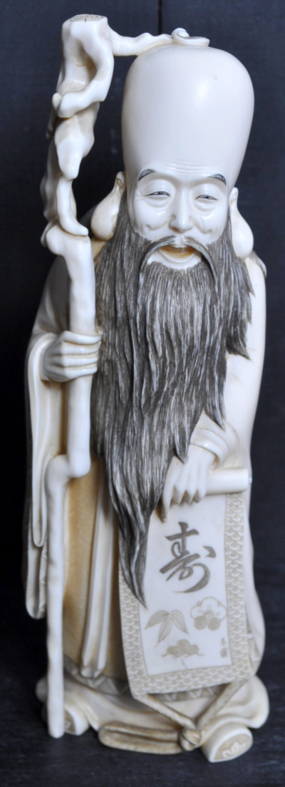 Japan, late 19th century - Character in sculpted ivory, signed